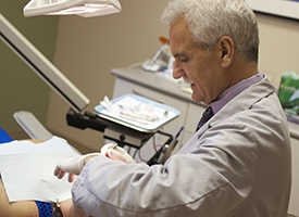 Dr. Carroll working on dental patient