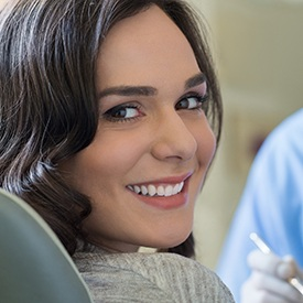 Woman in dental chair with beautiful smile