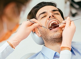 Man in dental chair receiving treatment